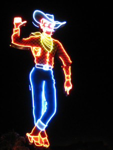 Cowboy_sign_of_the_Pioneer_Hotel_&_Gambling_Hall